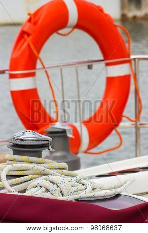 Yachting, Colorful Rope With Orange Lifebuoy On Sailboat