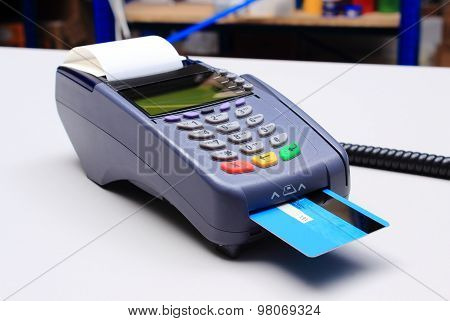 Payment Terminal With Credit Card On Desk In Shop