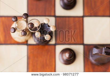 two wedding rings on chessboard