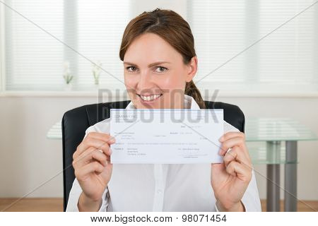 Businesswoman Showing Cheque
