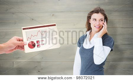 Happy blonde on the phone against bleached wooden planks background