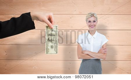 Businesswoman smiling on a white background against overhead of wooden planks