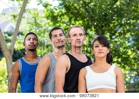 Focused extreme athletes standing in a row in the city