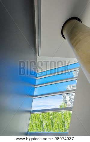 Window and blue sky. Abstract fragment of the architecture of modern lobby, hallway of the luxury hotel, shopping mall, business center in Vancouver, Canada. Interior design.