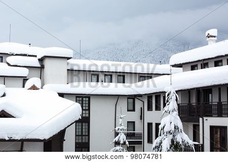 Deep Snow On The Roof Of Chalet