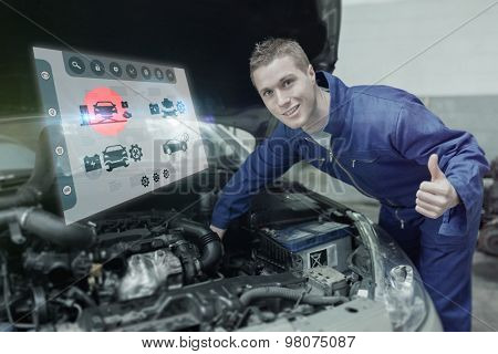Engineering interface against mechanic under car bonnet gesturing thumbs up