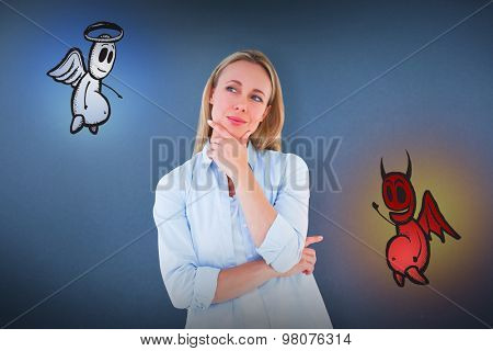 Pretty blonde thinking with hand on chin against blue background