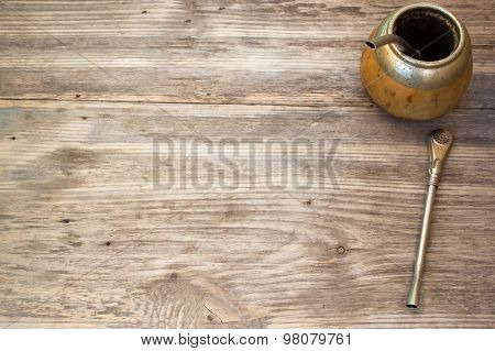Calabash And Bombilla With Yerba Mate On Wooden Background. Copy Space To Right.