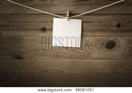Blank Message Pegged To String Against Wood Planks