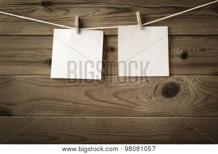 Blank Reminder Notes Pegged On Clothesline