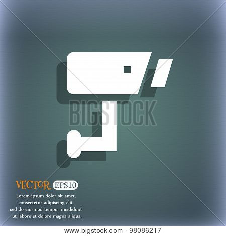 Surveillance Camera  Icon Symbol On The Blue-green Abstract Background With Shadow And Space For You