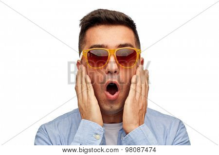 summer, emotions, style and people concept - face of scared or surprised middle aged latin man in shirt and sunglasses