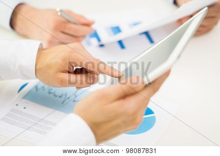 business, people, technology and teamwork concept - close up of businessman hands with tablet pc computer blank screens at office