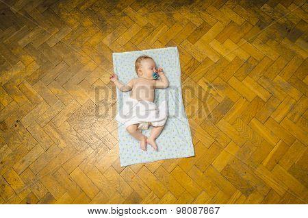 Newborn baby lying on the blanket