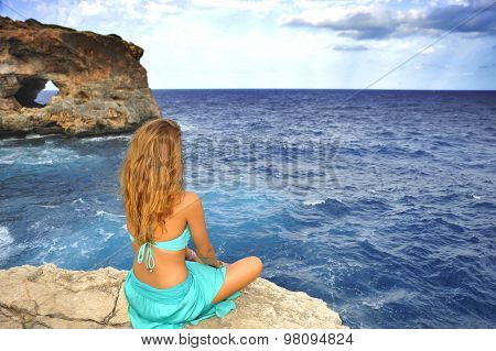 Young Attractive Woman Looking At Sea Horizon Sitting Alone On R