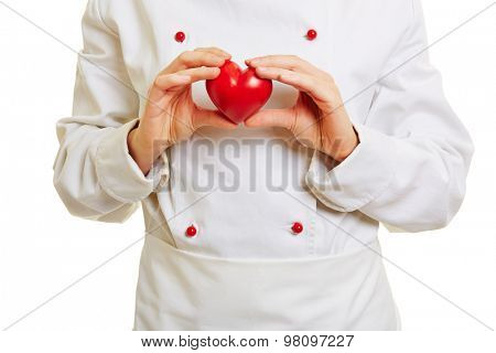 Chef cook holding a red heart in front of the workwear