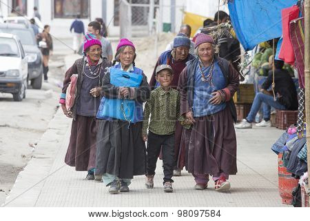 Tibetan Buddhist Old Women And Boy On The Streets In Leh. Ladakh, North India