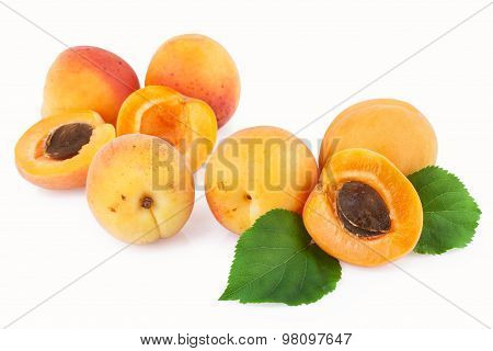 Apricot fruits scattered isolated on white