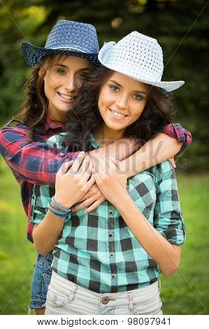 sexy girl in cowboy hats and plaid shirts