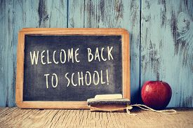 stock photo of red back  - a chalkboard with the text welcome back to school written in it - JPG