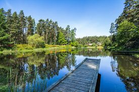 stock photo of dock a lake  - Old dock and a calm lake - JPG