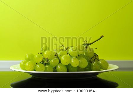 Fine white grapes in modern kitchen