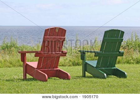 2 Adirondack Chairs With Ocean View To Reduce Your Stress