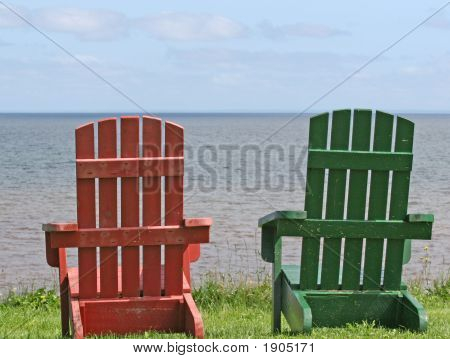 The Backs Of 2 Chairs With Ocean View