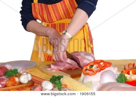 Housewife Cutting Meat