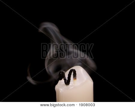 Extinguished Candle With Smoke Above It