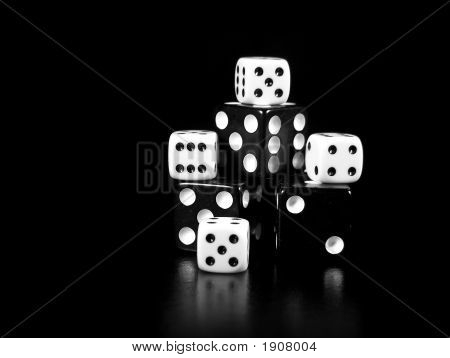 Black And White Dice On Black Background