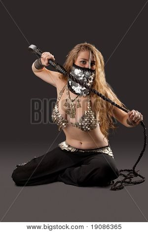 Woman with knout in chain mail - oriental costume