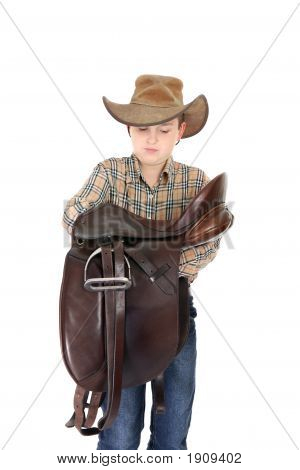 Rural Boy Holding A Saddle