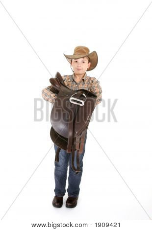 Boy Carrying A Saddle