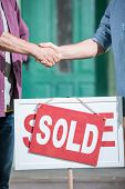 Cropped View Of Men Shaking Hands With Saleman And Buying New House poster