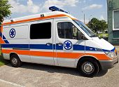 stock photo of first aid  - side of an ambulance in front of the first aid station - JPG