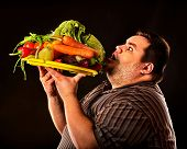 Diet fat man eating healthy food with vegetables for overweight male. Male trying to lose weight fir poster