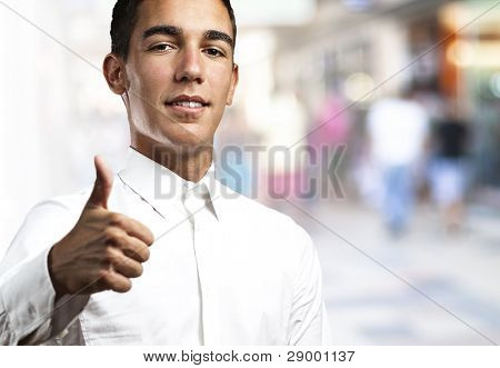 young business man with thumb up at city