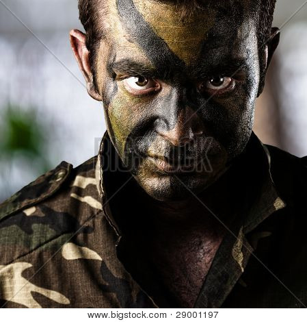 portrait of young soldier face over abstract background