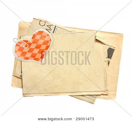 Sheet of old paper with red heart, for scrapbooking design. Isolated over white