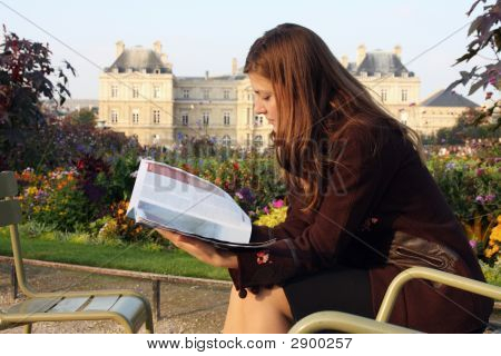 Pretty Girl Reading Magazine In Luxembourg Garden