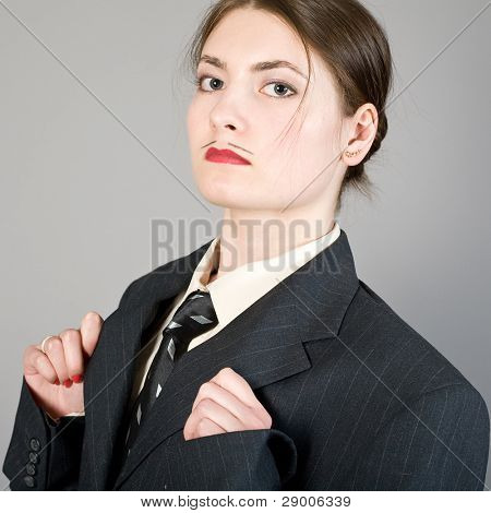 Portrait of the girl in a man's suit before theatrical representation
