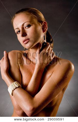 beautiful young girl with water drops on a body