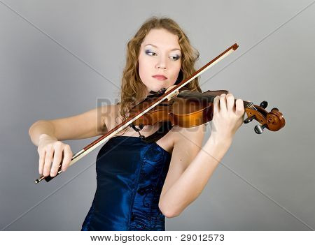 young beautiful girl with a violin