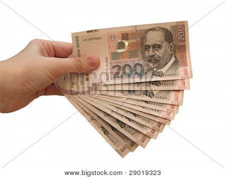 Hand holding croatian money- kuna