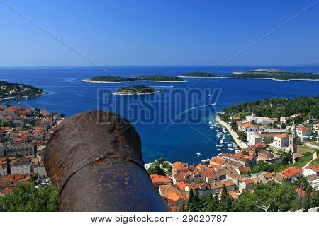 Aerial view of marina on island Hvar, Croatia with cannon on the left