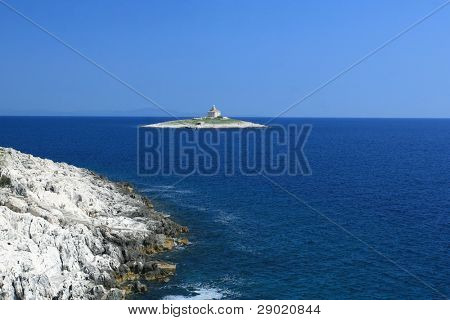 Sea view with lighthouse on a small island