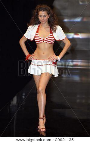 Fashion model walking down the runway