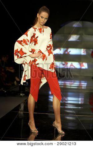 Fashion model posing on a catwalk
