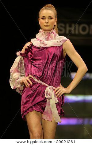 Fashion model in pink silk dress